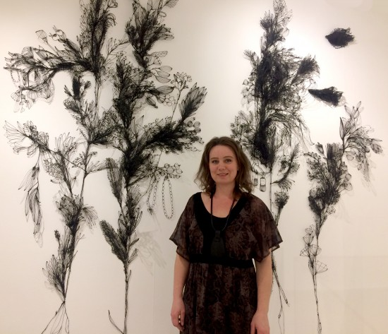 Sofia Björkman in front of her wall installation What has the bird done?